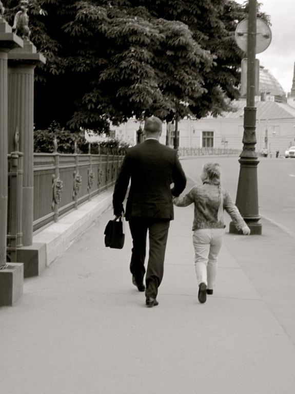8′ clock, a dad taking a walk with his daughter on the way to his work.  The lightness and candor of the little girl offsets the strictness of the dad's figure, body and motion